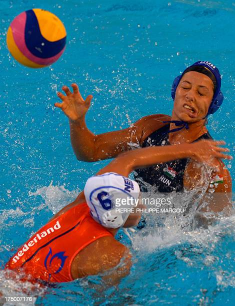 Hungary's Gabriella Szucs fights for the ball with the Netherlands's Nomi Stomphorst during their women's water polo quarterfinals match at the FINA...