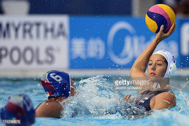 Hungary's Gabriella Szucs vies with Italy's Rosaria Aiello during their preliminary round match Hungary vs Italy of the women's water polo...