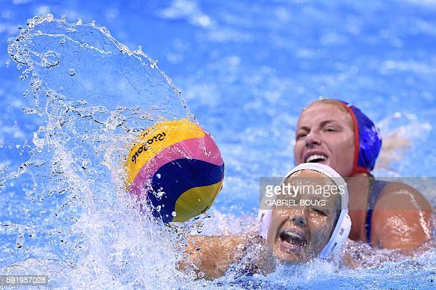 Hungary's Gabriella Szucs vies with Russia's Anna Timofeeva during their Rio 2016 Olympic Games waterpolo Bronze medal match on August 19 2016 at the...
