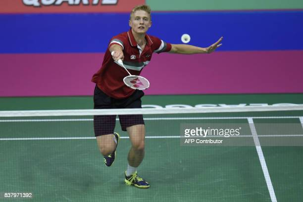 Hungary's Gergely Krausz returns to Korea's Wan Ho Son during their round two mens's singles match during the 2017 BWF World Championships of...