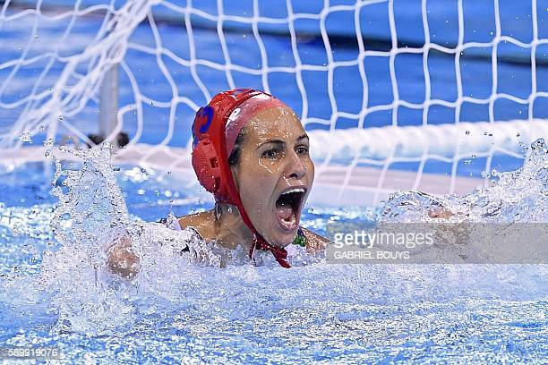 Hungary's goalie Orsolya Kaso celebrates after saving a goal during the Rio 2016 Olympic Games waterpolo qauerterfinal match against Australia at the...