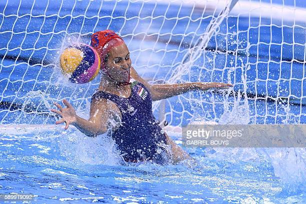 Hungary's goalie Orsolya Kaso saves a goal during the Rio 2016 Olympic Games waterpolo qauerterfinal match against Australia at the Olympic Aquatics...