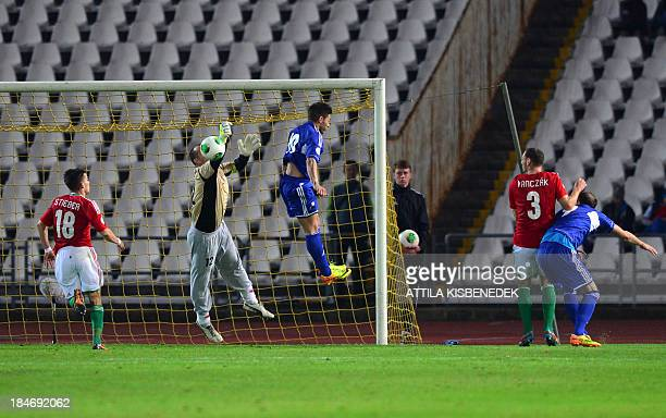 Hungary's goalkeeper Gabor Kiraly saves the ball against Andorra's and forward Ivan Lorenzo during the FIFA 2014 World Cup group D qualifying...