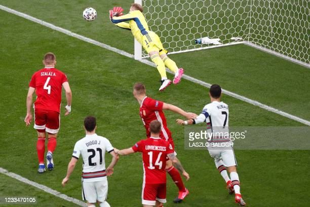 Hungary's goalkeeper Peter Gulacsi saves a shot on goal during the UEFA EURO 2020 Group F football match between Hungary and Portugal at the Puskas...