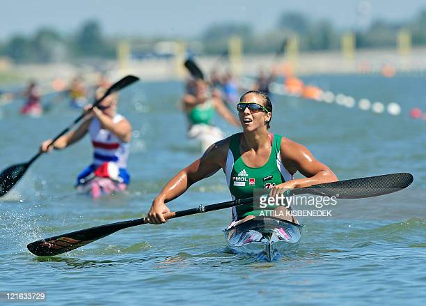 Hungary's gold medalist Tamara Csipes arrives at the finish line of the women's K1 5000m final in the 39th ICF Canoe Sprint World Championships on...