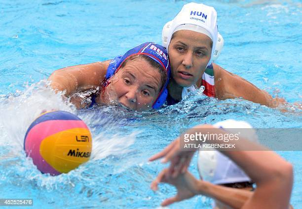 Hungary's Hanna Kisteleki fights for the ball with Russia's Maria Borisova during the women's Water Polo European Championships match Hungary vs...