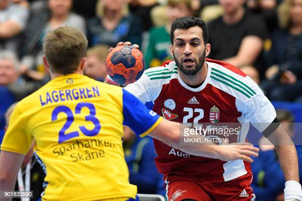 Hungary's Iman Jamali plays the ball during a friendly handball match between Sweden and Hungary at Kinnarp Arena Jonkoping Sweden on January 6 2018...