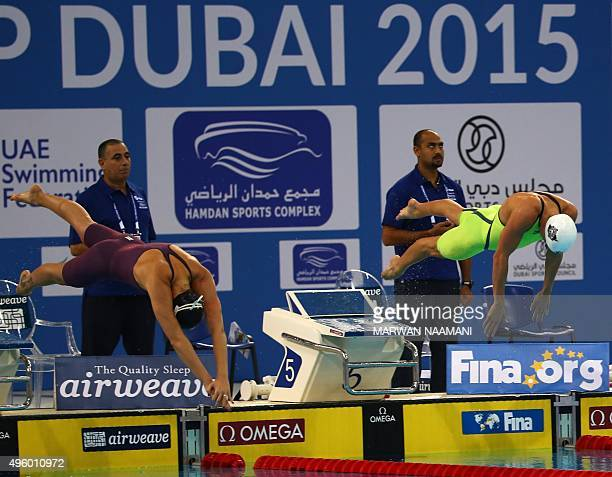 Hungary's Katinka Hosszu and Italy's Federica Pellegrini compete in the Women's 200m Freestyle final during the FINA World Swimming Cup 2015 on...