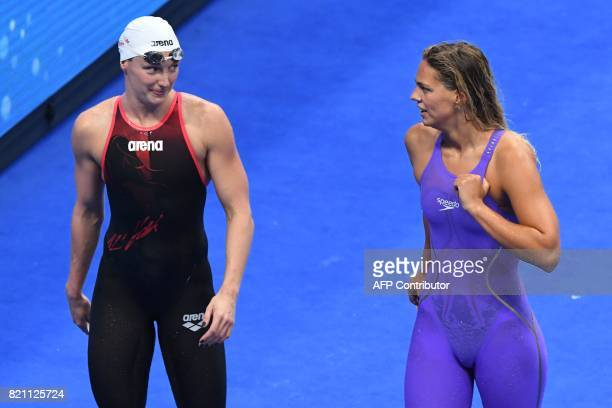 Hungary's Katinka Hosszu and Russia's Yuliya Efimova react after competing in a women's 200m medley heat during the swimming competition at the 2017...