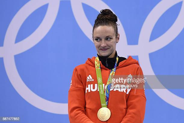 Hungary's Katinka Hosszu celebrates with her gold medal on the podium after she won the Women's 100m Backstroke Final during the swimming event at...