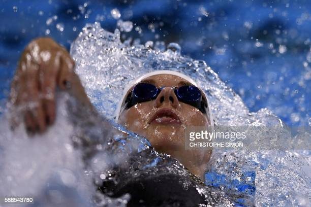 TOPSHOT Hungary's Katinka Hosszu competes in a Women's 200m Backstroke heat during the swimming event at the Rio 2016 Olympic Games at the Olympic...
