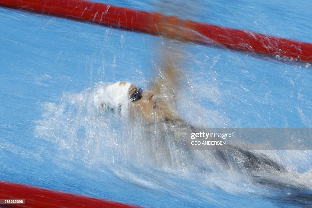 TOPSHOT - Hungary's Katinka Hosszu competes in the Women's 200m Backstroke Semifinal during the swimming event at the Rio 2016 Olympic Games at the Olympic Aquatics Stadium in Rio de Janeiro on August 11, 2016. / AFP / Odd Andersen