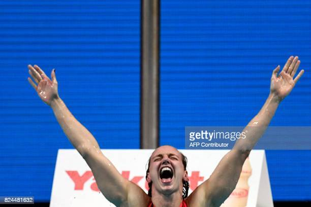 Hungary's Katinka Hosszu reacts after competing in the final of the women's 400m individual medley during the swimming competition at the 2017 FINA...
