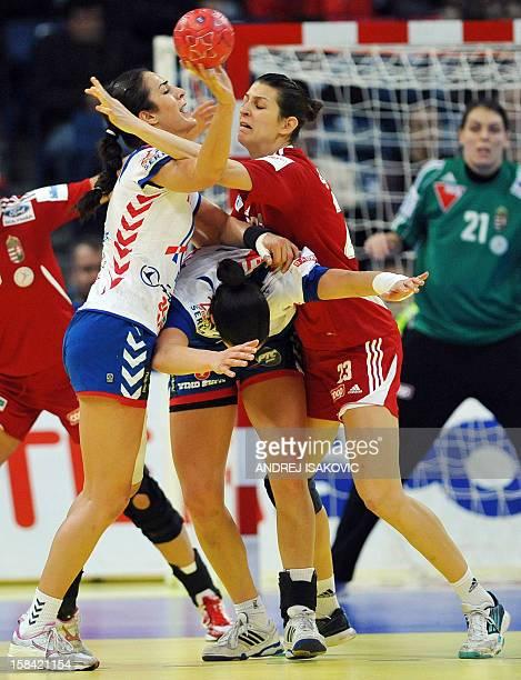 Hungary's Klara Szekeres vies for the ball with Serbia's Sanja Damjanovic and Andrea Lekic during the women's EHF Euro 2012 Handball Championship...