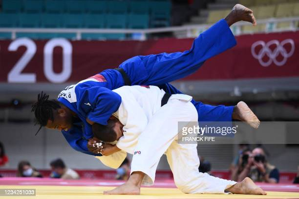 Hungary's Krisztian Toth and Refugee Olympic Team's Popole Misenga compete in the judo men's -90kg elimination round bout during the Tokyo 2020...