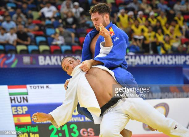 Hungary's Krisztian Toth fights against Spain's Nikoloz Sherazadishvili in their men's under 90kg category semifinal bout of the 2018 Judo World...