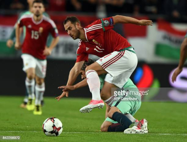 Hungary's Marton Eppel vies with Portugal's Fabio Coentrao during the FIFA World Cup 2018 qualification football match between Hungary and Portugal...