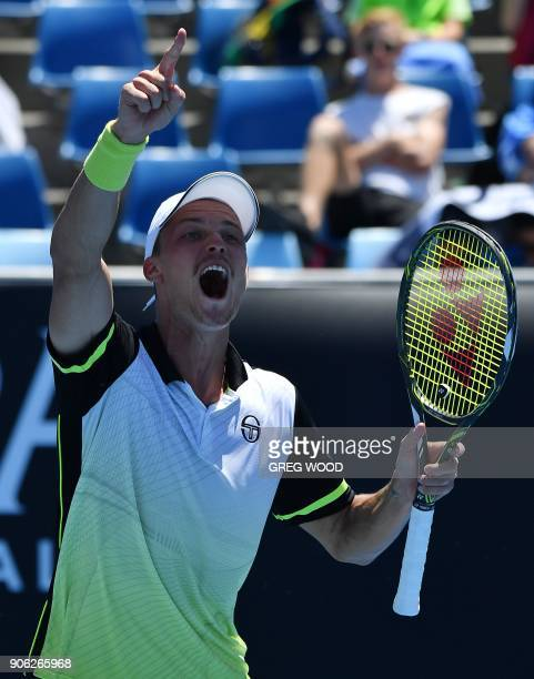 Hungary's Marton Fucsovics celebrates beating Sam Querrey of the US in their men's singles second round match on day four of the Australian Open...