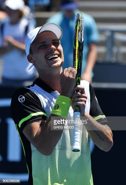 Hungary's Marton Fucsovics reacts after beating Sam Querrey of the US in their men's singles second round match on day four of the Australian Open...