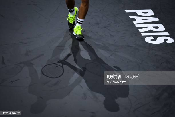 Hungary's Marton Fucsovics reacts as he plays against Croatia's Borna Coric during their men's singles first round tennis match on day 1 at the ATP...
