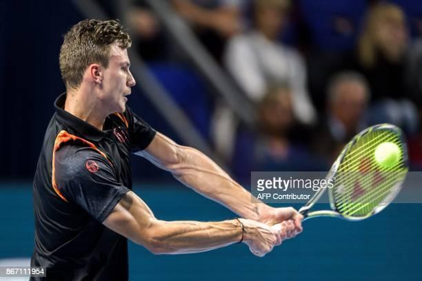 Hungary's Marton Fucsovics returns a ball to Croatia's Marin Cilic during their quarterfinal game at the Swiss Indoors ATP 500 tennis tournament on...