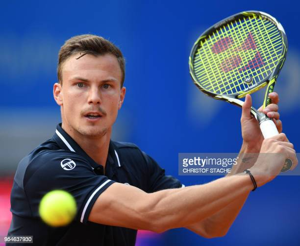 Hungary's Marton Fucsovics returns the ball to Germany's Maximilian Marterer during their quarter final match at the ATP tennis BMW Open in Munich...