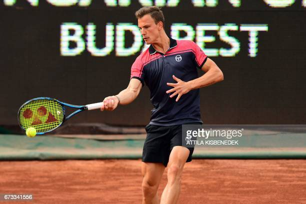 Hungary's Marton Fucsovics returns the ball to Spain's Fernando Verdasco during their tennis match at the Hungarian Open in Budapest on April 26 2017...