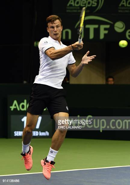 Hungary's Marton Fucsovics returns to Belgium's David Goffin during their tennis match as part of the Davic Cup World group tie between Belgium and...