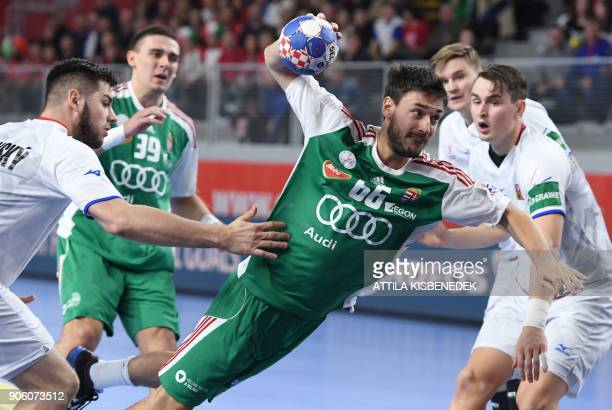 Hungary's Mate Lekai shoots to score a goal during the group D match of the Men's 2018 EHF European Handball Championships between Czech Republic and...
