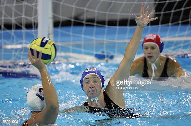 Hungary's Mercedes Stieber and goalkeeper Patricia Horvath defend the goal against Canada's Johanne Begin during their women's water polo semifinal...