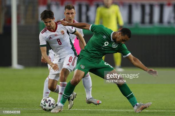 Hungary's midfielder Adam Nagy and Ireland's forward Adam Idah vie for the ball during the friendly football match between Hungary and the Republic...