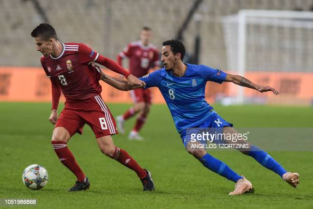 Hungary's Midfielder Adam Nagy vies with Greece's Midfielder Carlos Zeca during the UEFA Nations League football match between Greece and Hungary at...