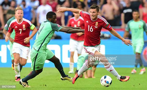 Hungary's midfielder Adam Pinter vies with Portugal's midfielder William Carvalho during the Euro 2016 group F football match between Hungary and...