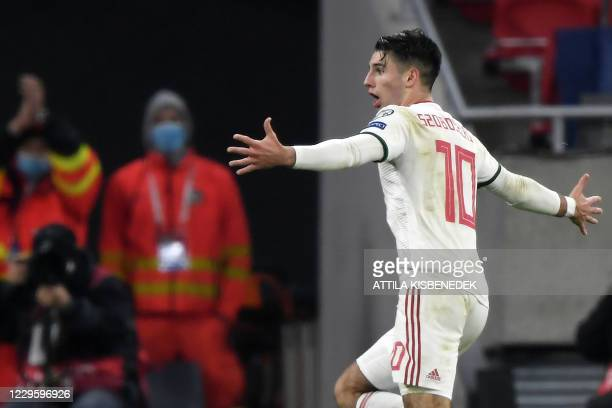 Hungary's midfielder Dominik Szoboszlai celebrates after scoring the team's second goal during the UEFA European Qualifiers play-off final football...