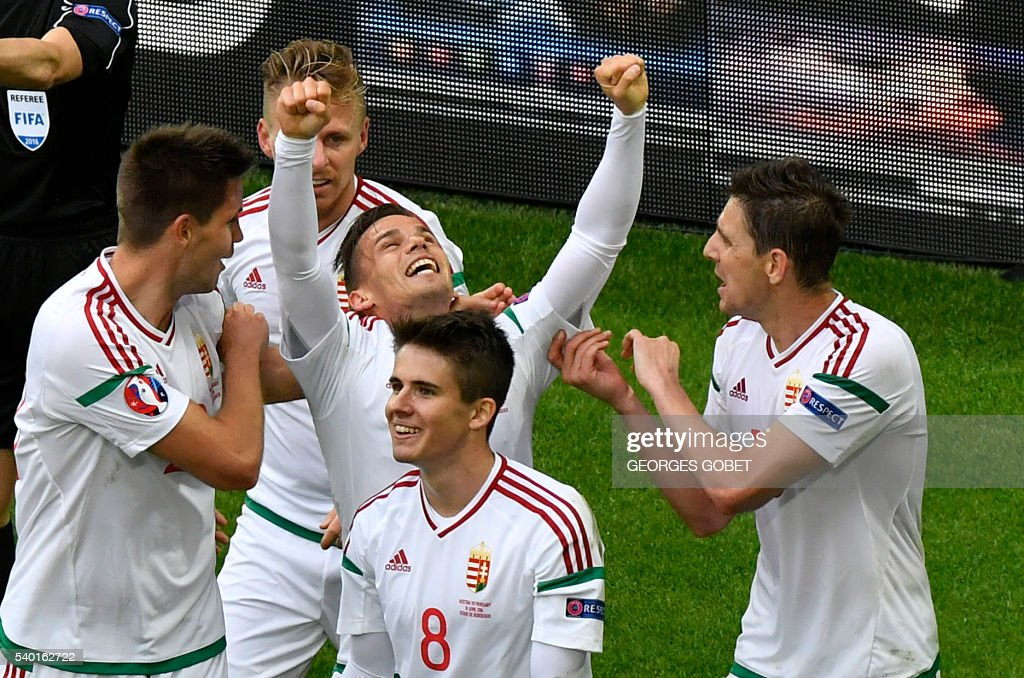 Hungary's midfielder Zoltan Stieber (3rd R) celebrates after scoring his team's second goal during the Euro 2016 group F football match between Hungary and Austria at the Matmut Atlantique stadium in Bordeaux on June 14, 2016. / AFP / GEORGES