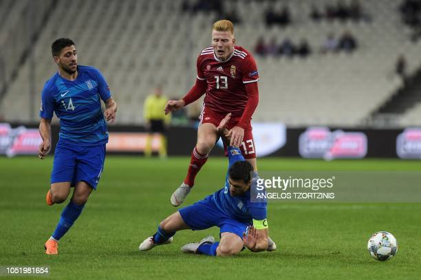 Hungary's midfielder Zsolt Kalmar vies with Greece's Defender Sokratis Papastathopoulos during the UEFA Nations League football match between Greece...