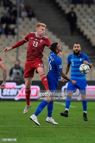 Hungary's midfielder Zsolt Kalmar vies with Greece's midfielder Dimitris Kourbelis during the UEFA Nations League football match between Greece and...