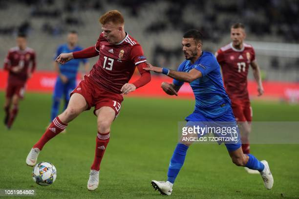 Hungary's Midfielser Zsolt Kalmar vies with Greece's Midfielser Dimitris Kourbelis during the UEFA Nations League football match between Greece and...