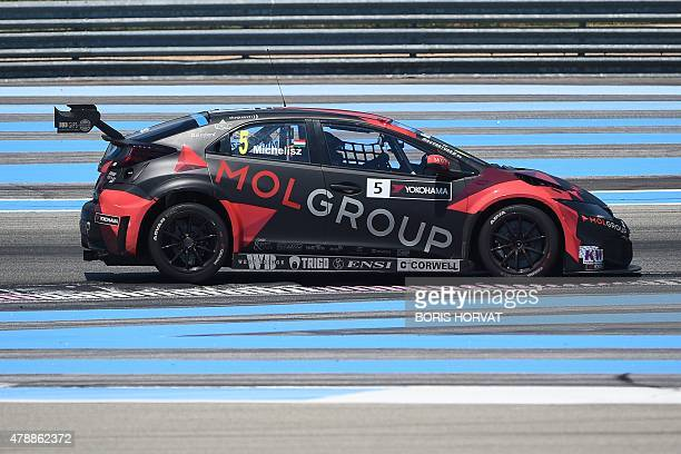 Hungary's Norbert Michelisz competes in the FIA World Touring Car Championship in Le Castellet southern France on June 28 2015 AFP PHOTO / BORIS...