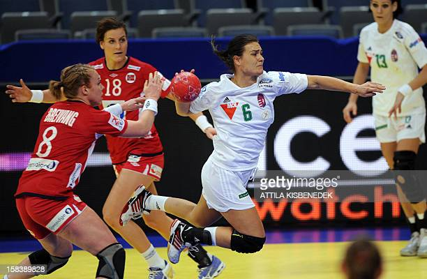 Hungary's Orsolya Verten scores a goal between Norway's LinnKristin Riegelhuth Koren and Norway's Karoline Dyhre Breivang during the 2012 EHF...