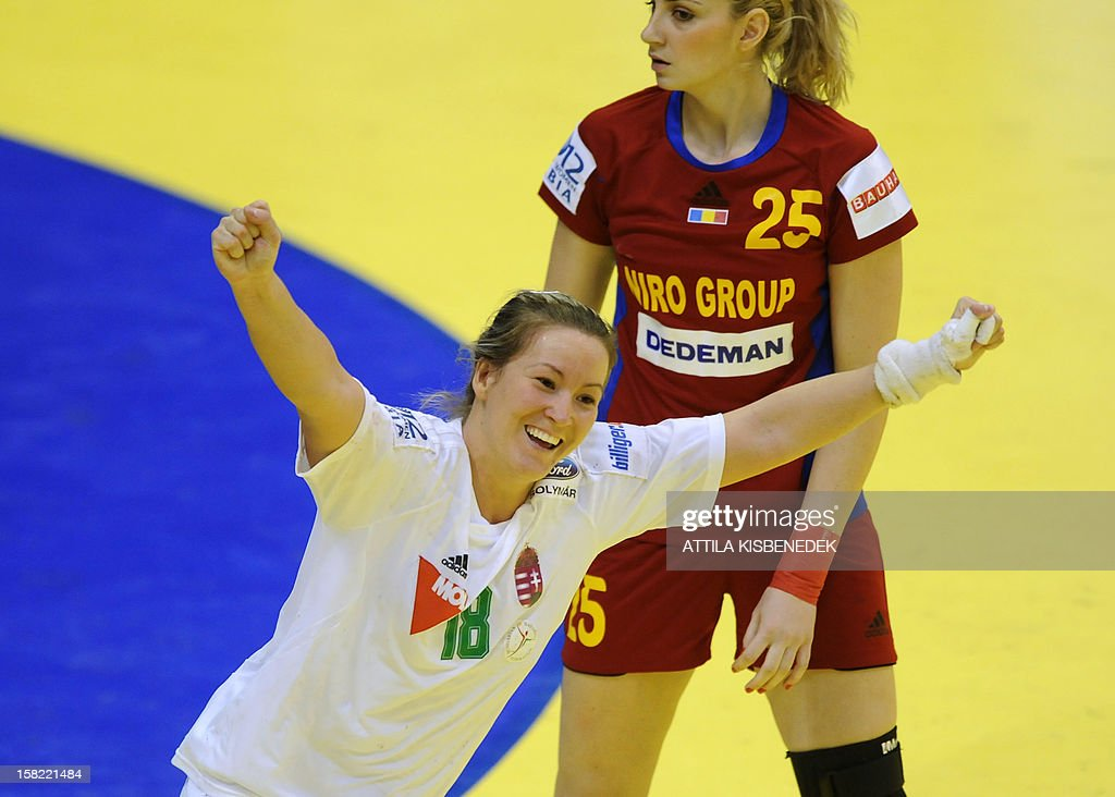 Hungary's Piroska Szamoransky (L) celebrates scoring next to Romania's Clara Vadineanu (R) during the 2012 EHF European Women's Handball Championship Group II match of the main round on December 11 , 2012, at the local arena of Novi Sad town. Hungary won 25-19.