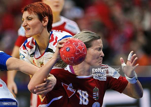 Hungary's Piroska Szamoransky vies for the ball with Serbia's Biljana Filipovic during the women's EHF Euro 2012 Handball Championship small final...