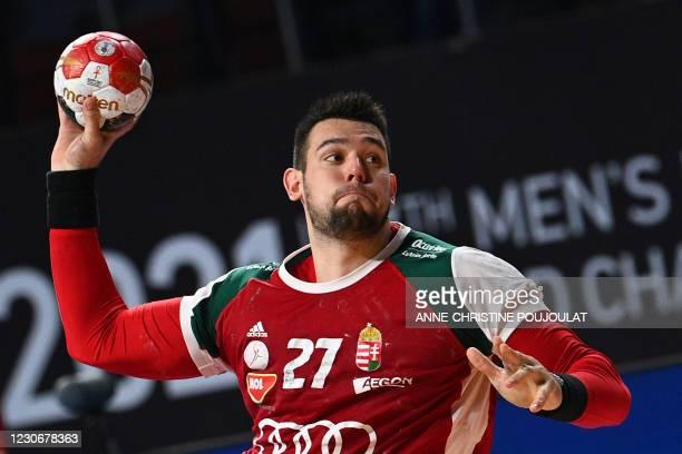 Hungary's pivot Bence Banhidi jumps to shoot during the 2021 World Men's Handball Championship match between Group A teams Germany and Hungary at the...