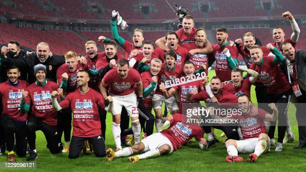 Hungary's players celebrate after Hungary won the match 2-1 and qualified for the Euro 2020 during the UEFA European Qualifiers play-off final...