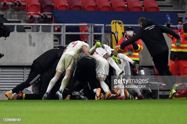 Hungary's players celebrate after Hungary's midfielder Dominik Szoboszlai scored a goal during the UEFA European Qualifiers play-off final football...