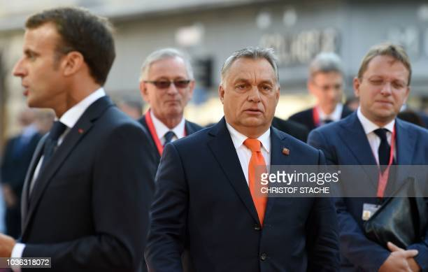 Hungary's Prime Minister Viktor Orban and France's President Emmanuel Macron arrive at the Mozarteum University to attend a plenary session part of...