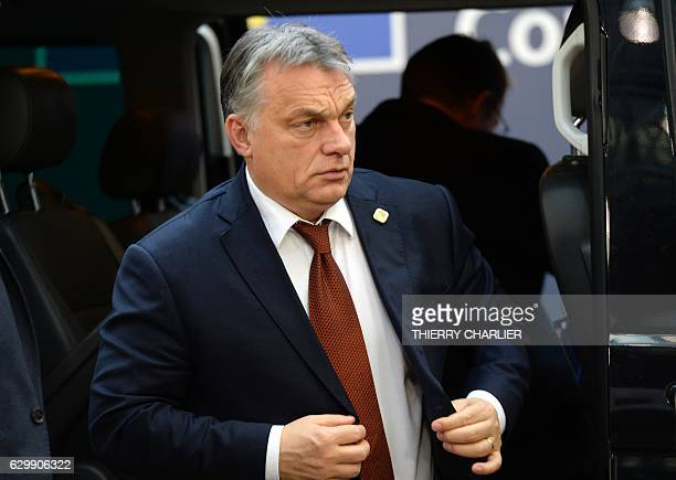 Hungary's Prime minister Viktor Orban arrives for a European Union leaders summit focused on Russia sanctions and migration at the European Council...