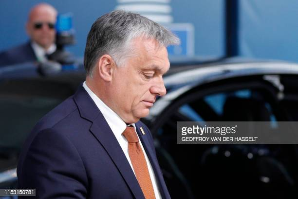 Hungary's Prime Minister Viktor Orban arrives for the third straight day of an European Union leaders summit in Brussels on July 2 for talks aimed at...