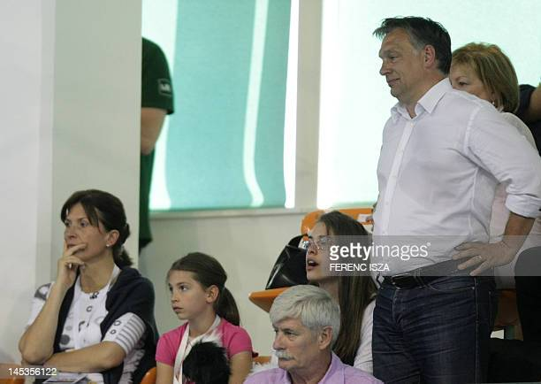 Hungary's Prime Minister Viktor Orban attedns with his wife jurist Aniko Levai and daughters the last evening of the swimming event in the 31st...