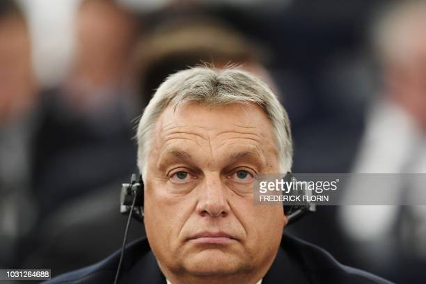 Hungary's Prime Minister Viktor Orban listens during a debate concerning Hungary's situation as part of a plenary session at the European Parliament...